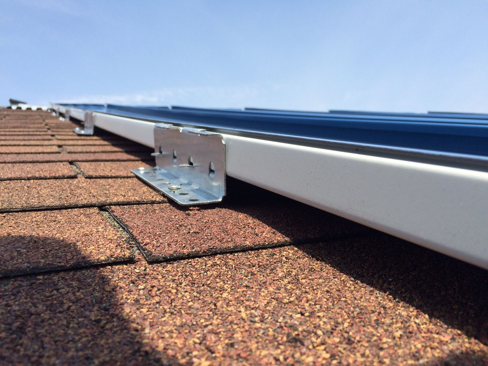 McElroy Metal Has Introduced A Quick And Efficient Method For Installing  Standing Seam Metal Roofing, Directly Over Asphalt Shingles, Without A  Tear Off.
