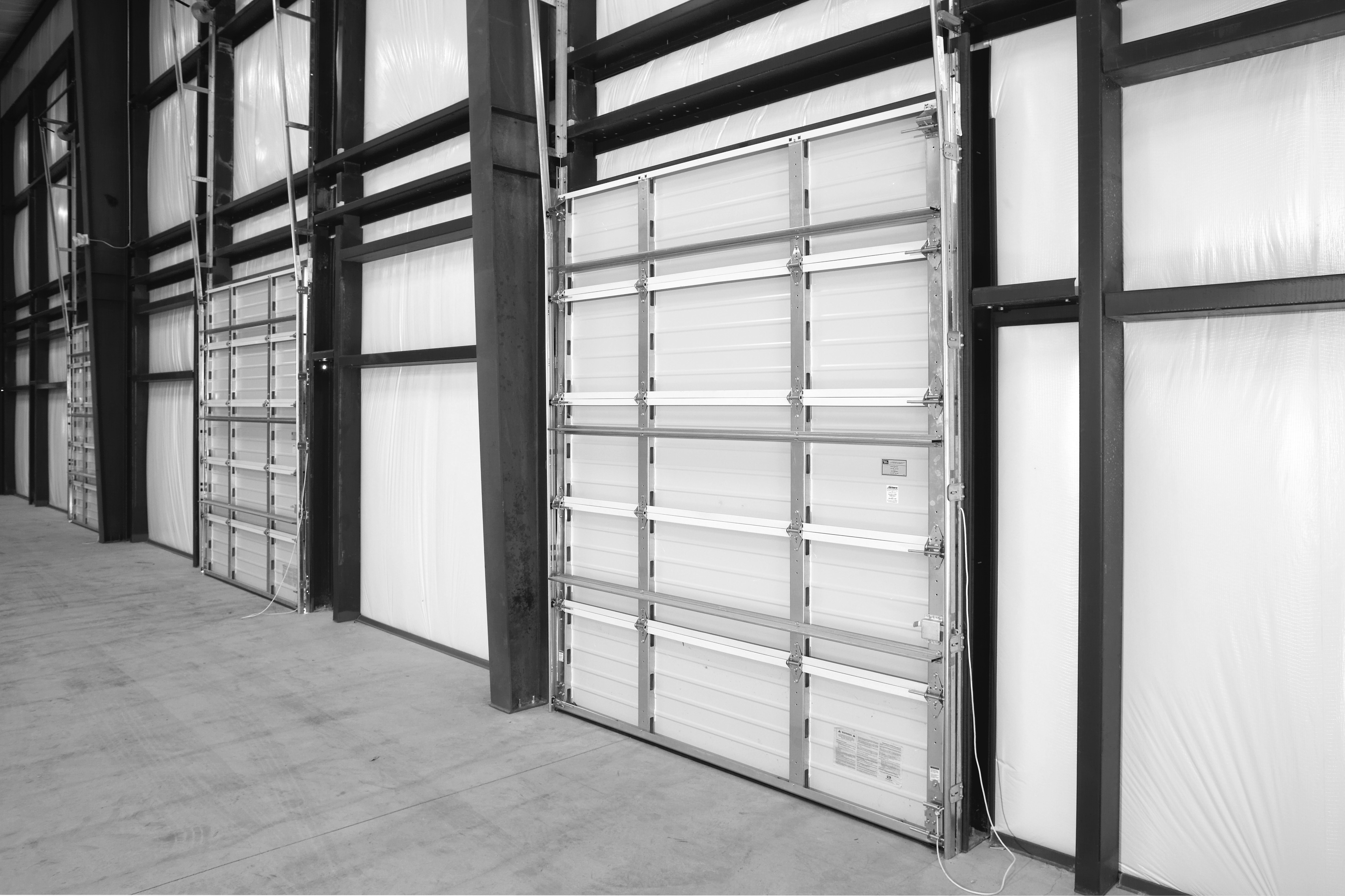 Wayne Dalton has introduced two new commercial sectional garage door options u2014 the Impact Section and Simple Install System u2014 for doors in environments ... & Wayne Dalton System for Commercial Sectional Doors | Commercial ...